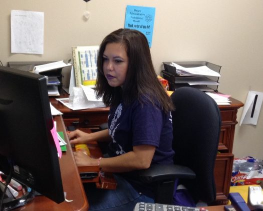 Registrar Monica Soria works on student transcripts.