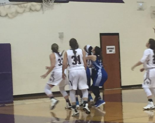 The Lady Bison get ready to rebound during an early-season game.