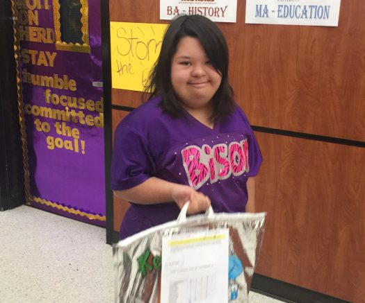 Lizette Vazquez helps deliver breakfast meals during first period.