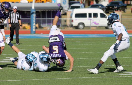 Junior Dirk Kilgore hangs onto the ball even through a tackle.