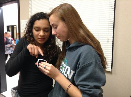 Junior Melanie Slay shows off her rings to classmate Yomele Almeida.