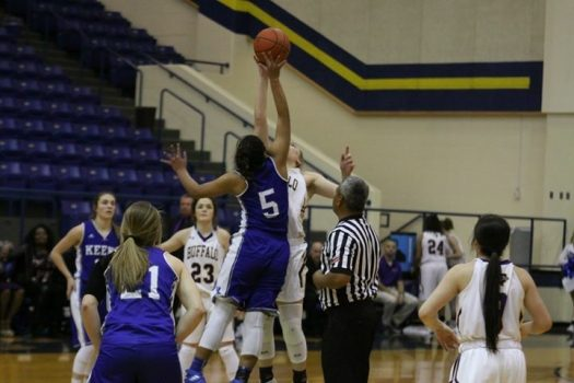 Mollie Dittmar goes up for the tip-off during the Lady Bison Bi-District game.