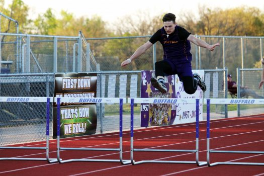 Colton Green takes on the 300-meter hurdles at the Bison track meet.