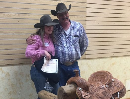 Katy Webb receives an award for her performance in rodeo.