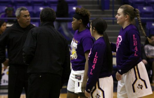 Mollie Dittmar and her co-captains chat with officials before the start of a district game.