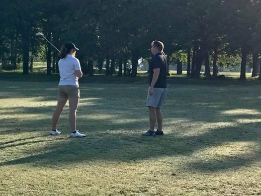 Junior Makayla Gilliam discusses her game with coach Robert Rubel.