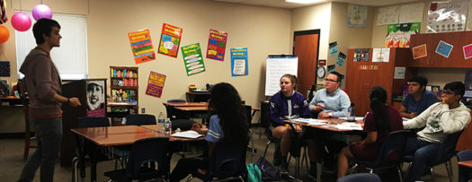 CX debate students listen as consultant Chris O'Brien discusses negative strategy in debate.