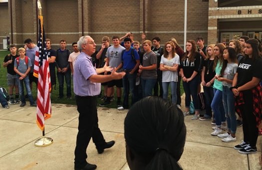 Students listen as Pastor Alan Grisham speaks at See You At The Pole.
