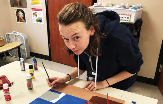 Senior Mykayla Dennix works on her art projects.
