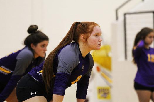 Sophomore Mackenzie Houston gets ready to receive a serve.