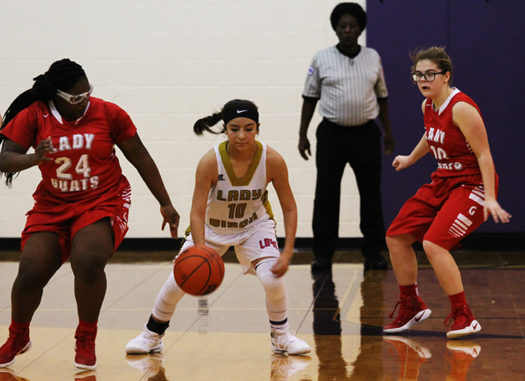 Sophomore Iris Valles heads towards the basket in a game against Groesbeck.