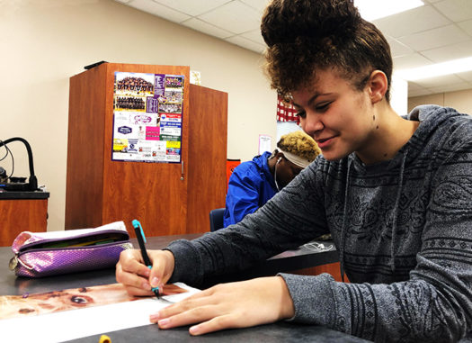 Freshman Aryonna Coleman works during Bison Pride class.