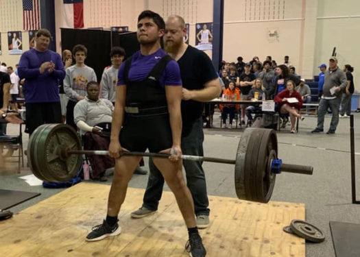 Senior Hector Dominguez lifts at a meet in Waco.