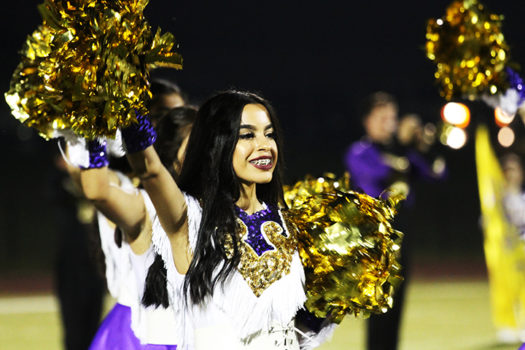 Jennifer Dominguez performs during halftime with the Bison Belles.