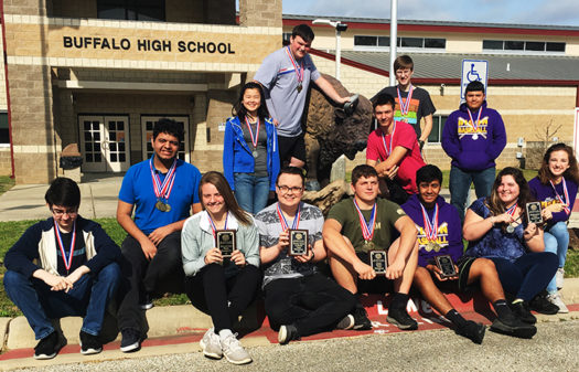Academic UIL students show off their medals and plaques from the first contest  day.