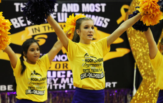 Sydney Lebel cheers during the Gold Out pep rally.