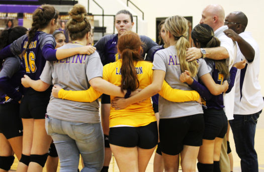 The Lady Bison huddle in a time-out during their game against Frankston.