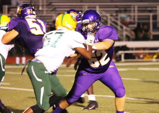 Freshman Lane Freeman keeps a Gateway player out of the action.