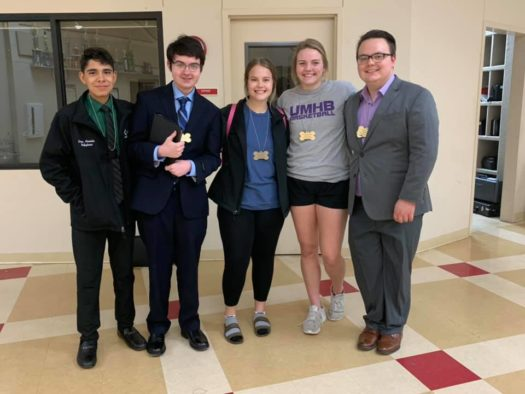 Speech and debate students show off their medals at the end of the Colmesneil meet.