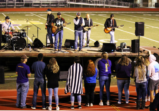 Students listen to the singing at Fields of Faith.