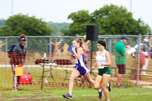 Senior Maddie Bates pushes herself during Regional XC competition.