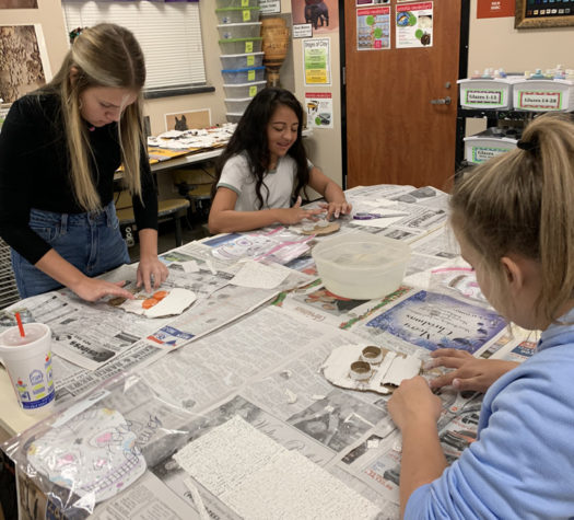 Art students form their sugar skulls before they add plaster.