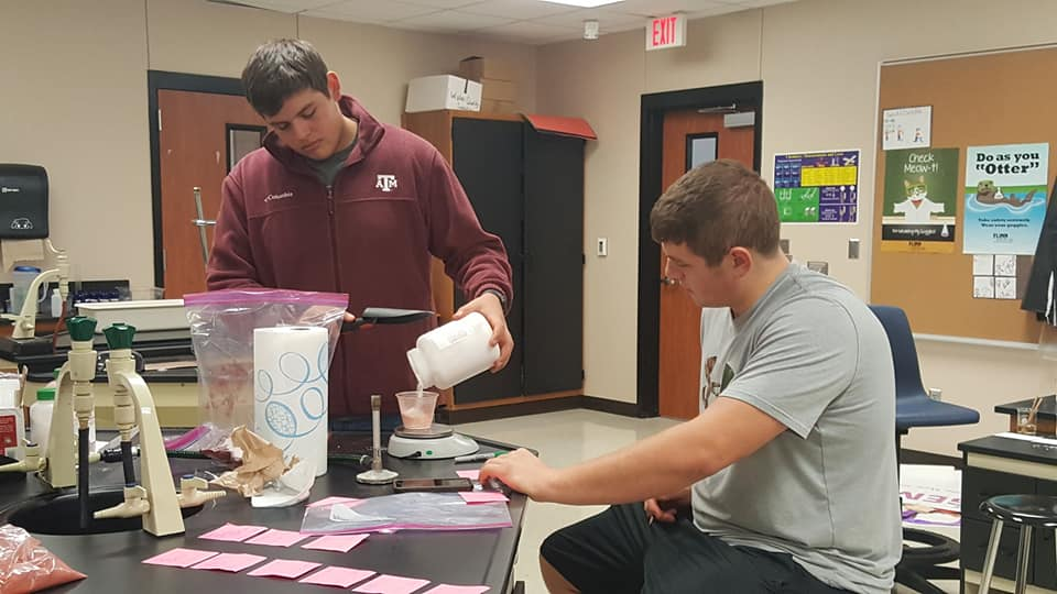 Science students Landon Folsom and Asa Henson work on their Mars project during class.