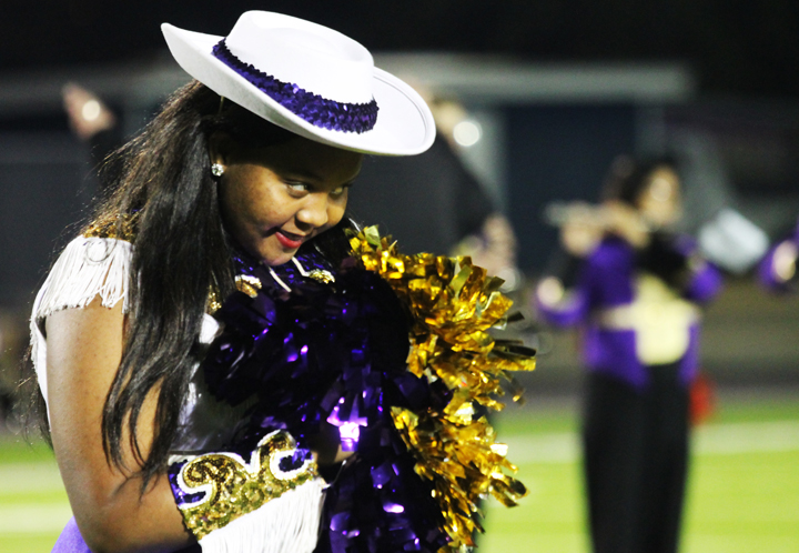 Mia Barrett watches for the signal to dance during a halftime performance.