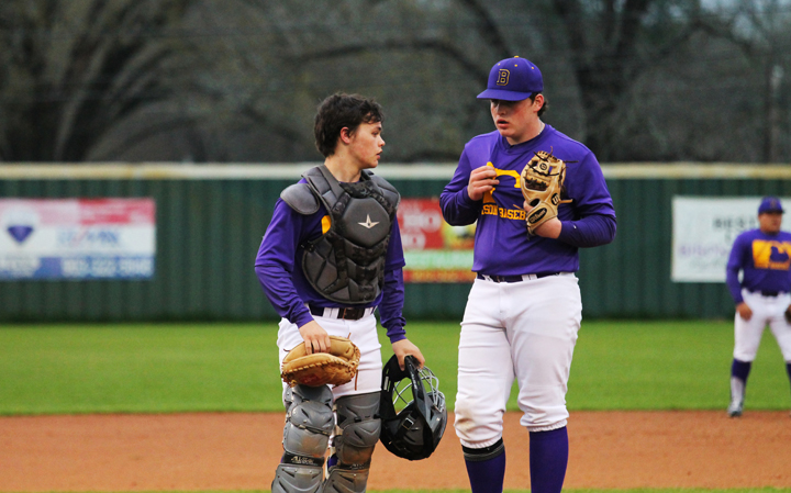 Freshman pitcher Zane Johnson confers with catcher Gavin Pruitt during a game.