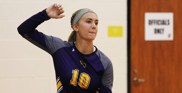 Sophomore Madison Walker gets ready to serve during a volleyball game.