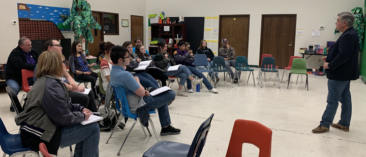 The OAP group listens to ideas from clinician Rick Garcia.