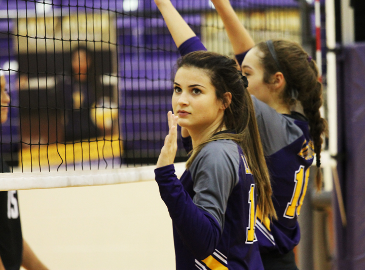 Sophomore Josie Henson gets ready for the serve during a volleyball game.