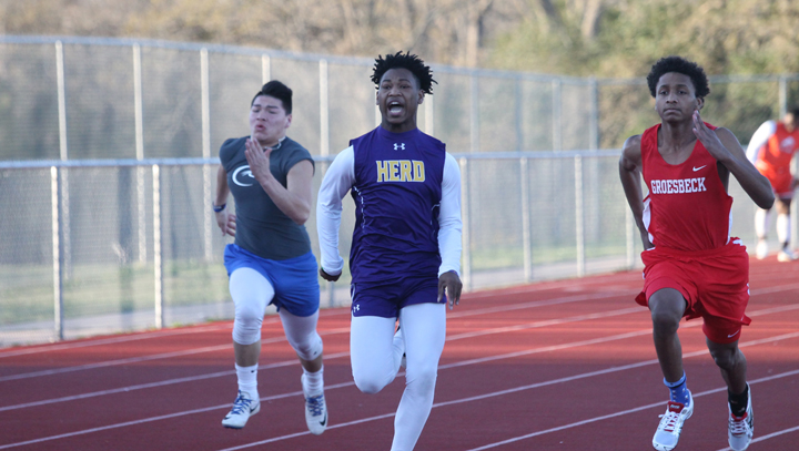 Sophomore Jamal Allen pushes to stay in front as he hits the finish line.