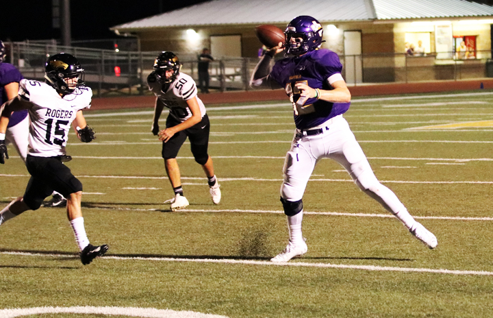 Quarterback Brett Hoffman goes back for the pass while playing Rogers.