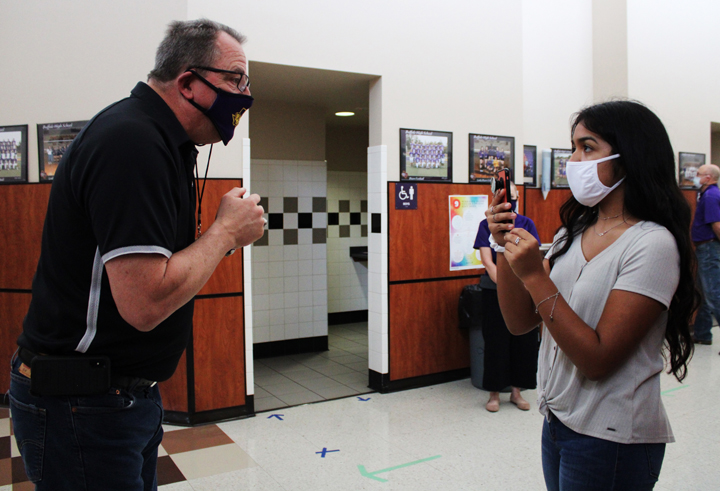 Senior Sherlynn Rodriguez films Principal John Clements during the first pep rally of the season.