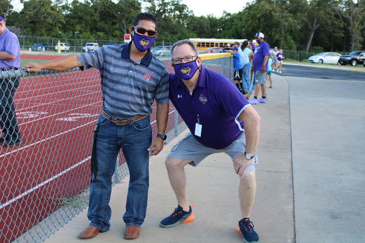 Principals John Clements and Lu Olvera goof around before a football game.