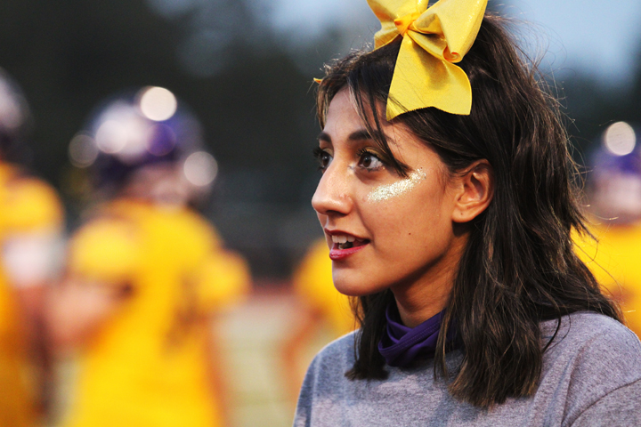 Freshman Amy Sanchez spends her Friday night cheering on the sidelines.