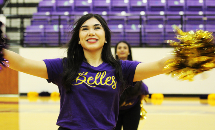 Junior April Martinez dances with the Belles at the first pep rally of the year.