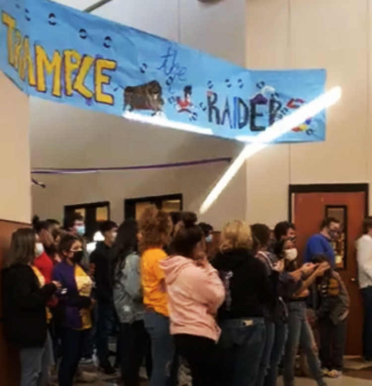 Students gather under the winning junior sign for the football sendoff.