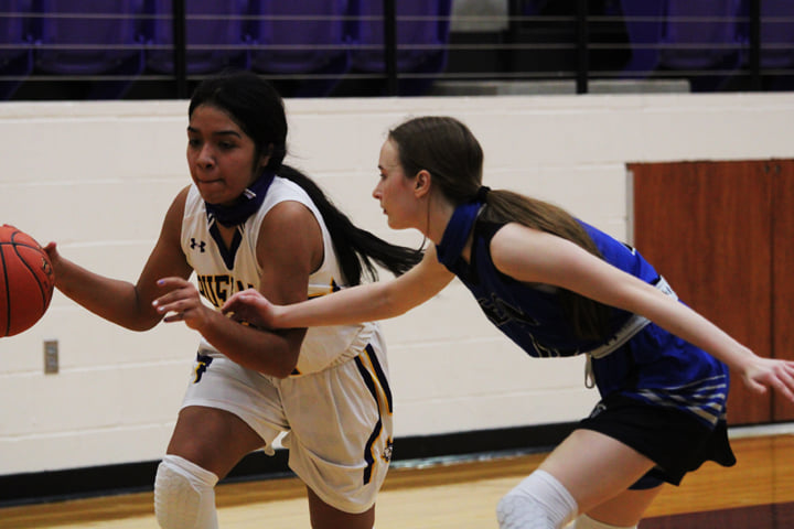 Sherlynn Rodriguez makes a break for the basket in a varsity game.