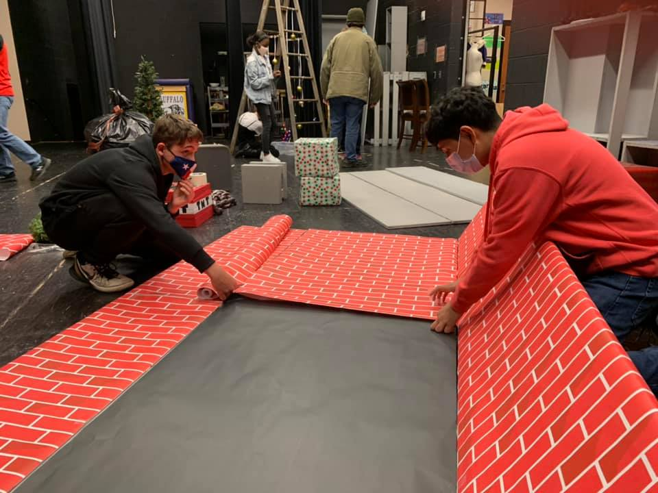 Peyton West and Omar Almeida work on decorations for the Christmas show, which has been canceled.