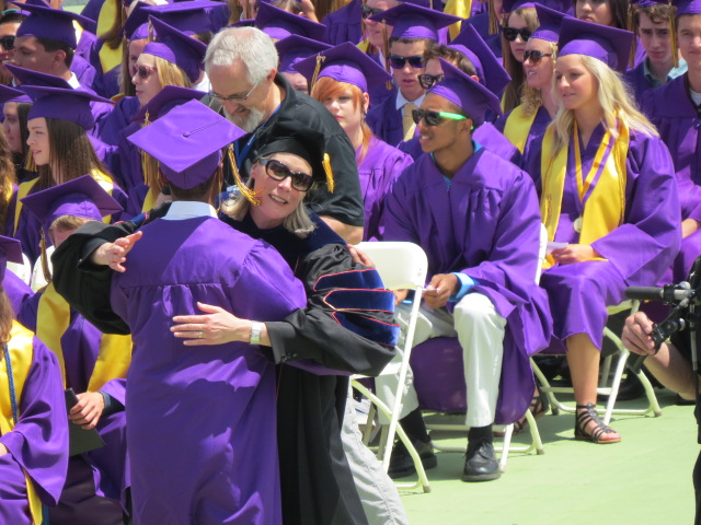 Dr. Amy Oaks hugs a graduate