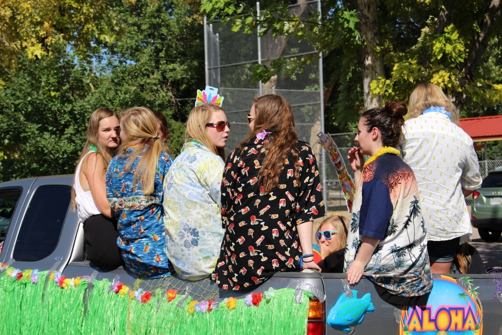 Juniors participate in the homecoming parade in their Hawaiian themed float