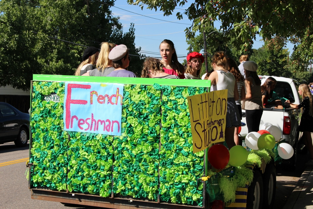 Freshman class participate in the homecoming parade in their French themed float