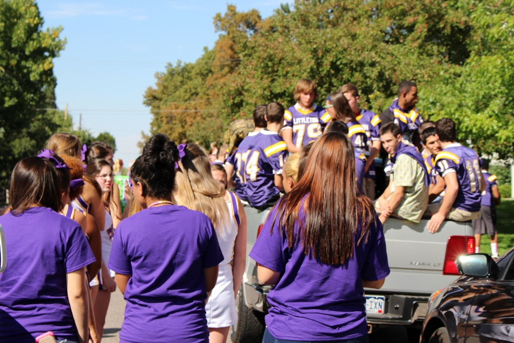 Varisty football gets ready to depart in the homecoming parade