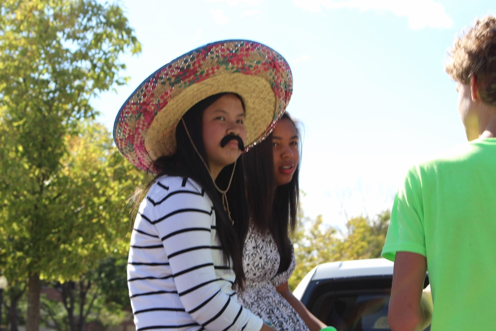 Sophomore Kathy Le rides in the Sophomore royalty float for the homecoming parade