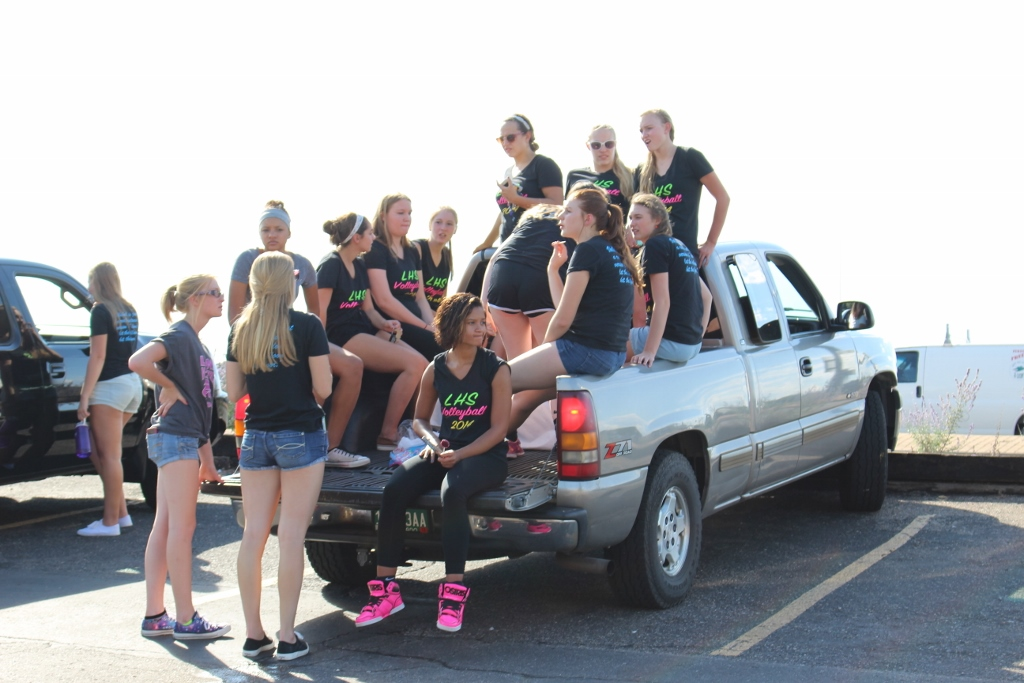 The Ladylion Volleyball team after they finished their debut in the homecoming parade
