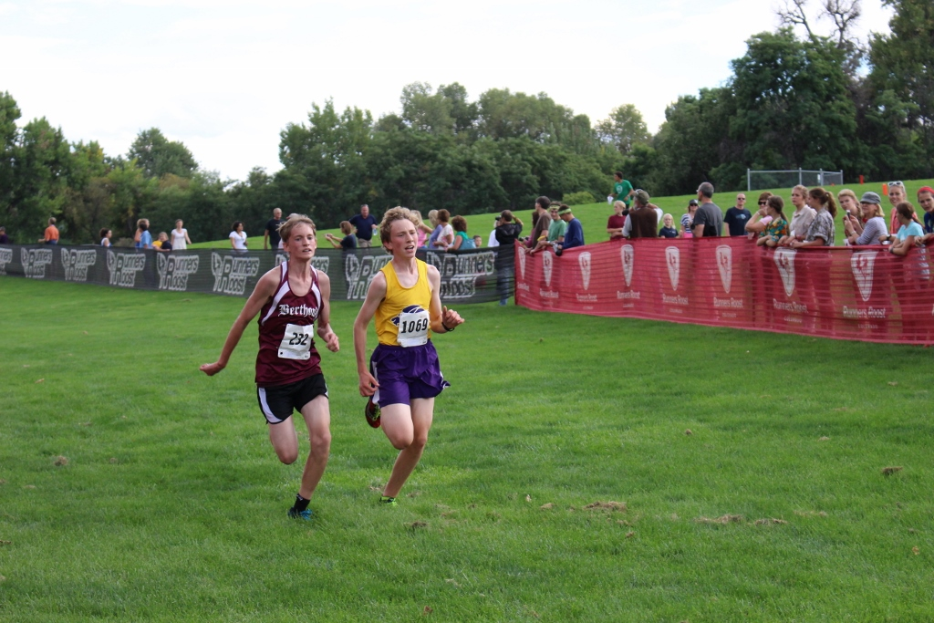 Junior Tyler Fuller goes head to head with another runner for the finishing stretch