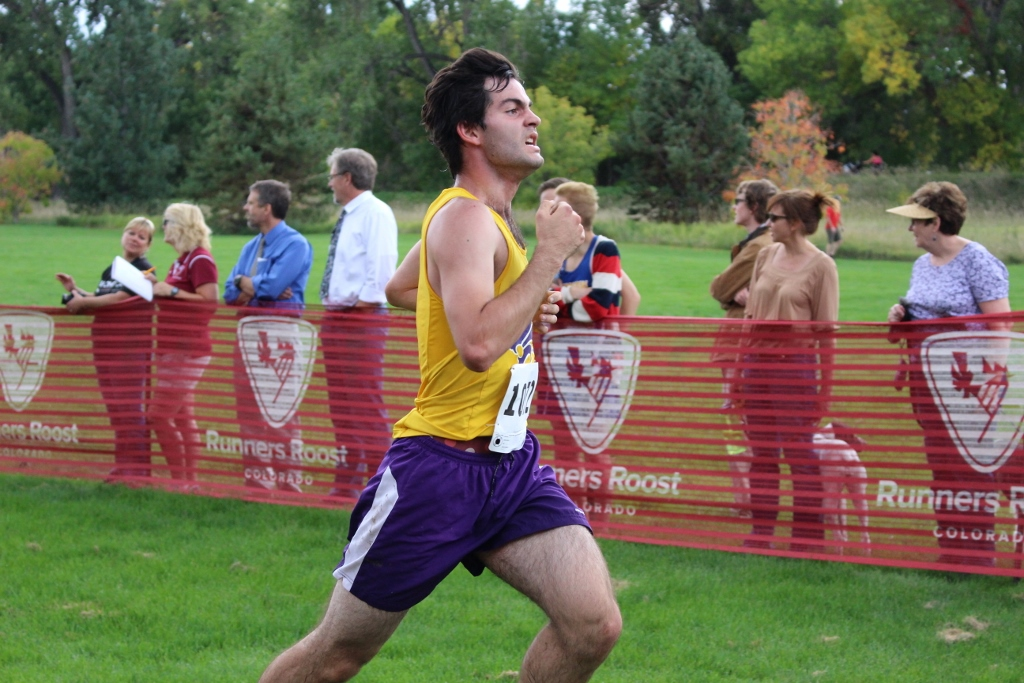 Senior Chris Malek pushes for the last part of his race