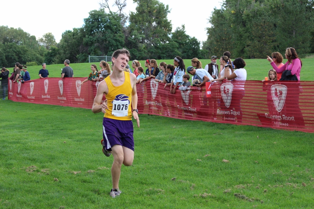 Sophomore Sam Robertson gives it his all in the last stretch of the LHS Invitational